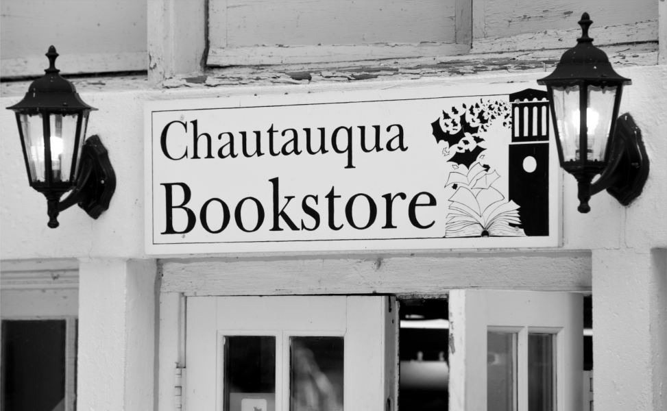 black and white image of Chautauqua Bookstore sign over front door